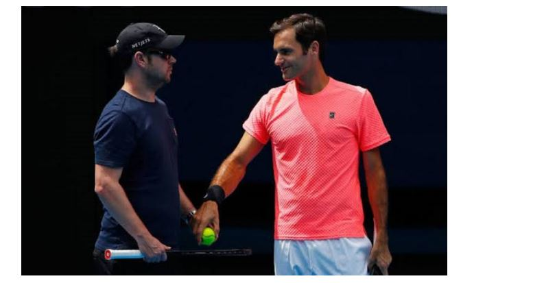 Roger Federer with coach snap