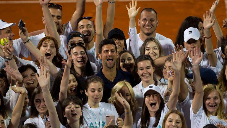 People cheering with Djokovic