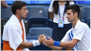 Carreno Busta and Djokovic shook hands after the Serb's disqualification was confirmed