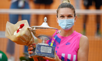 Romania's Simona Halep as she celebrates winning the final with the trophy after Czech Republic's Karolina Pliskova